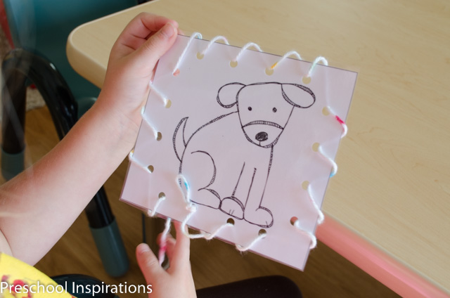 Practice fine motor skills with these adorable Brown Bear lacing card busy bag printables.