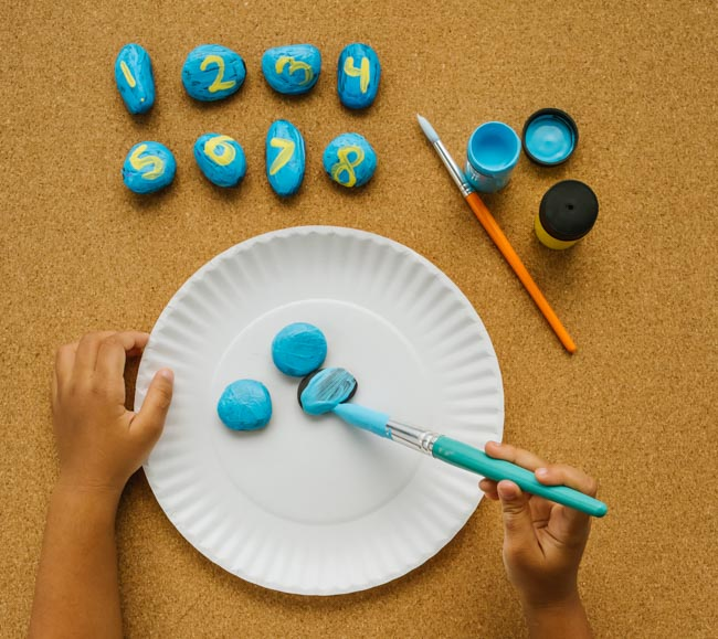 Make a nature-inspired rock clock to teach children math skills