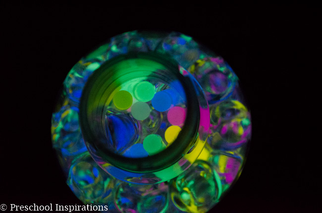 Make a super simple glow in the dark sensory bottle with glow sticks and water beads-3