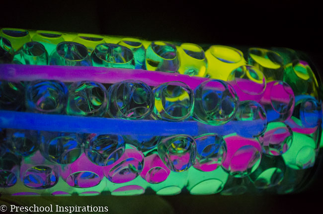 Make a super simple glow in the dark sensory bottle with glow sticks and water beads-5