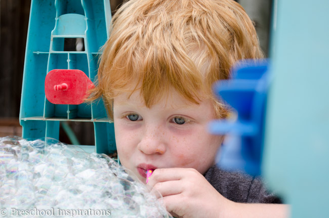 Let children make bubbles to their heart's content in this bubble blowing sensory table-6