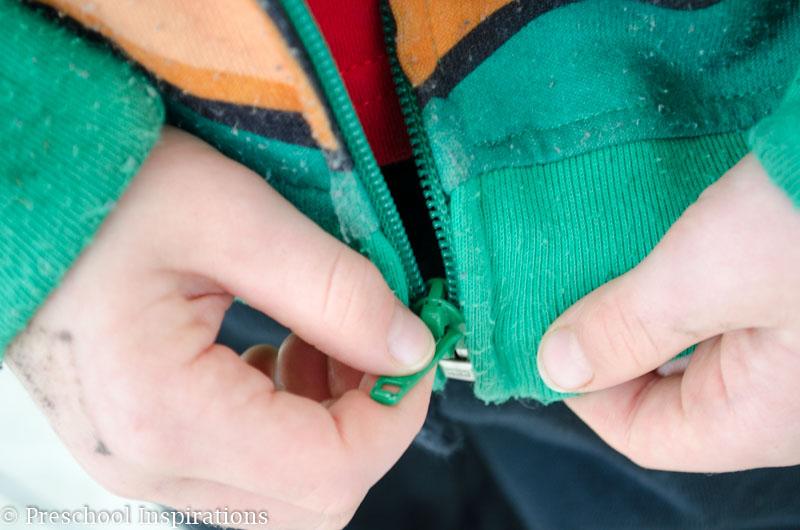 Teaching children how to zip their coats