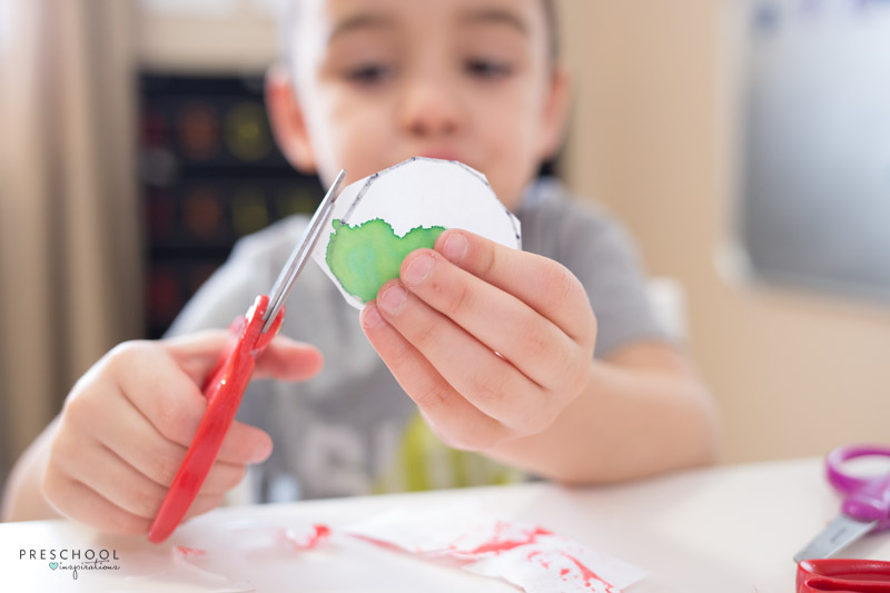 Set up a cutting tray for children to practice scissor skills with recycled art