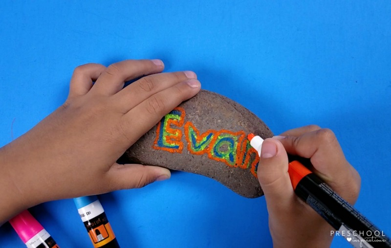 Teach children to write with a name rock.