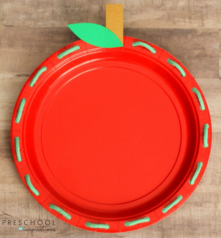 Work on fine motor skills with an apple paper plate lacing activity