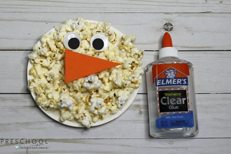 Make a popcorn paper plate snowman craft with the kids this winter