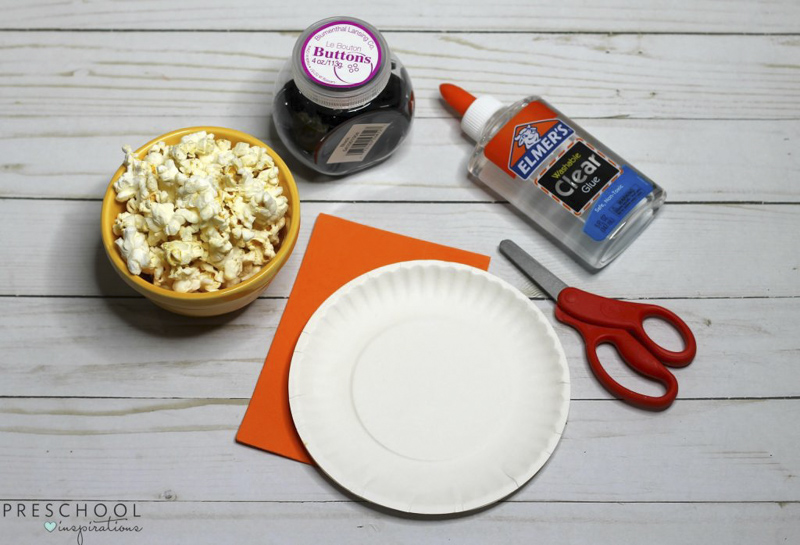 Materials to make popcorn paper plate snowman