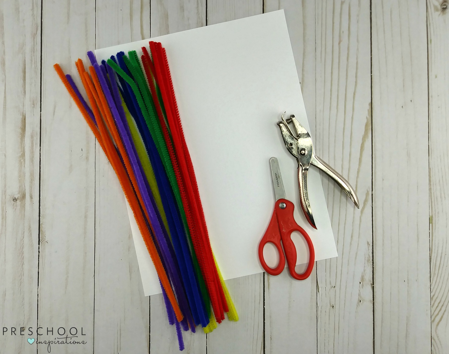 Materials to make a preschool rainbow craft