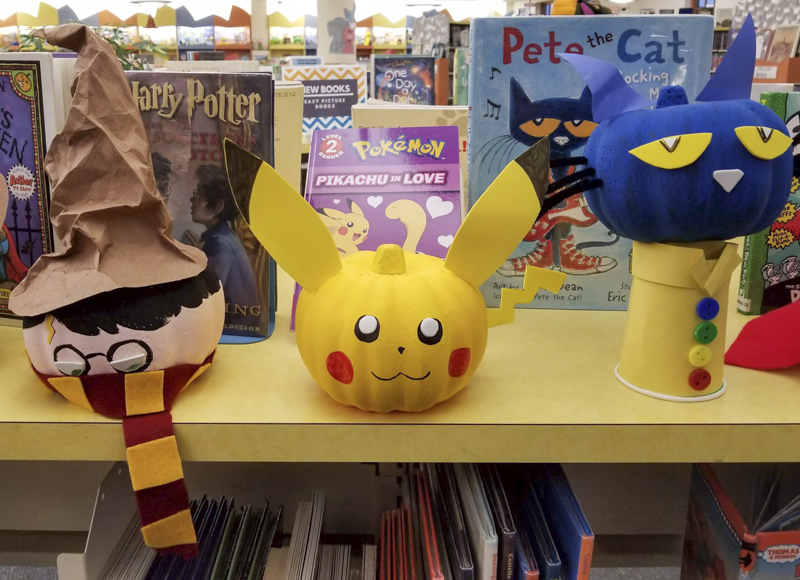 Harry Potter, Pikachu, and Pete the Cat pumpkin book character