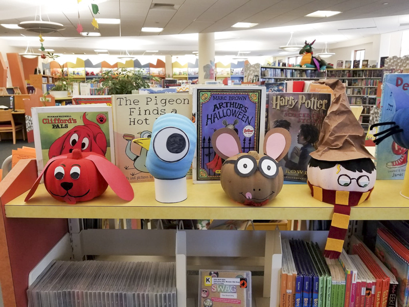 Clifford, Pigeon, Arthur, and Harry Potter pumpkin book characters