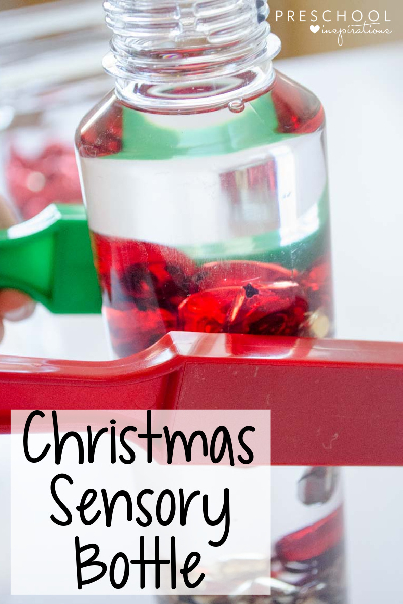 a magnetic wand on the side of a jingle bells sensory bottle with the text, 'Christmas sensory bottle'