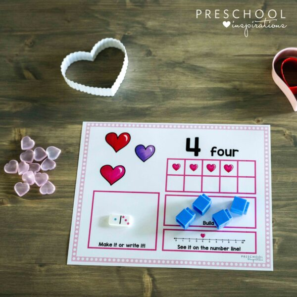 close up of a valentine's day counting mat showing four hearts in a 10-frame for the number four