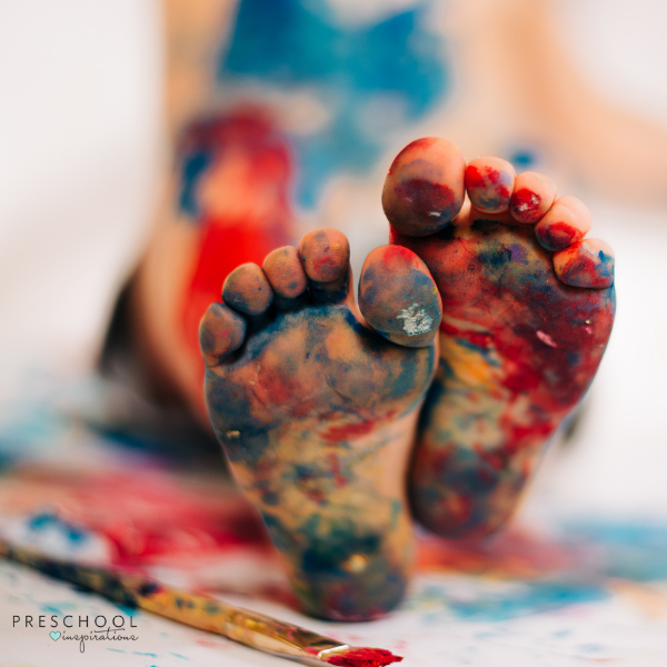 a 2-year-old's feet messy with paint
