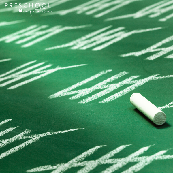 tally marks written in chalk on a green chalkboard
