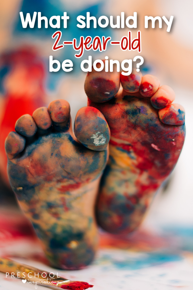 pinnable image of a toddler's feet covered in paint and the text 'what should my 2-year-old be doing?'