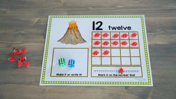 a blank dinosaur ten frame showing the number 12 with manipulatives