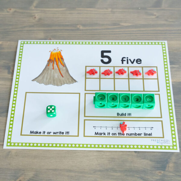 dinosaur ten frame filled with manipulatives showing the number five