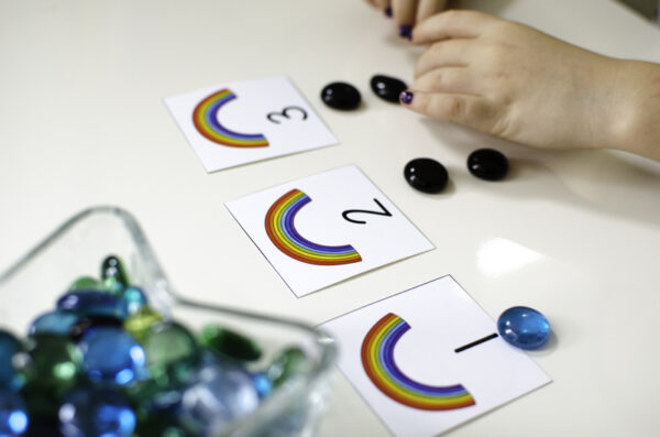 the numbers one, two, and three shown on rainbow counting cards