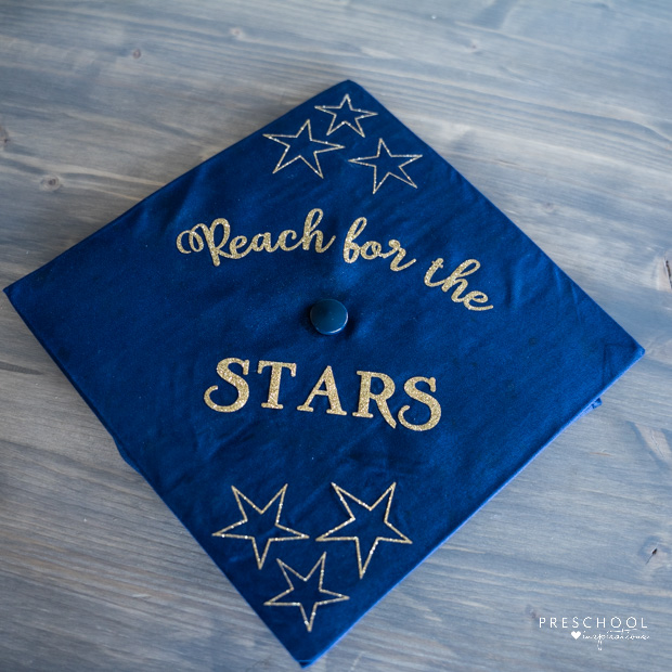 graduation cap with the cricut-made text 'reach for the stars' and six stars on it