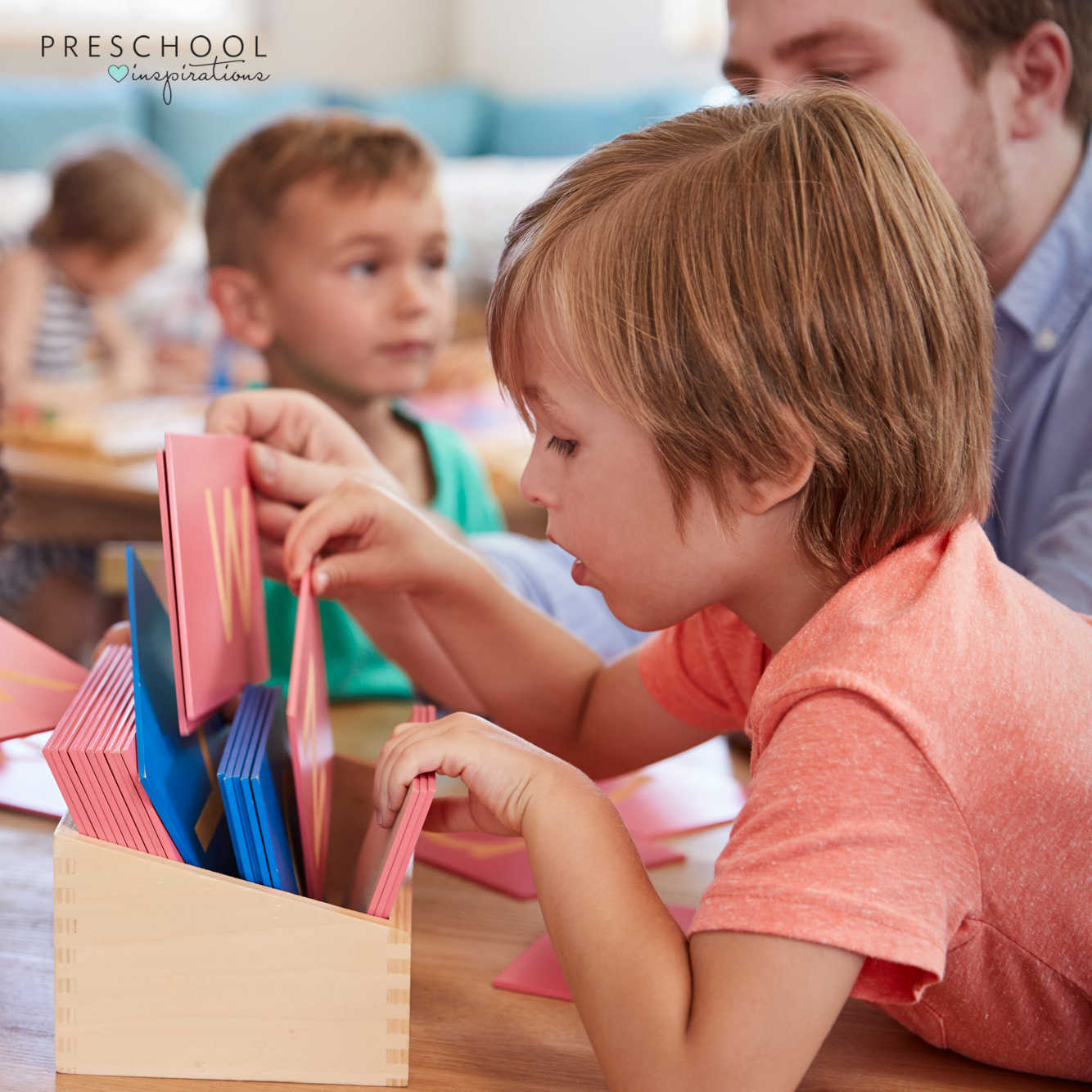 a preschool boy looks through alphabet cards